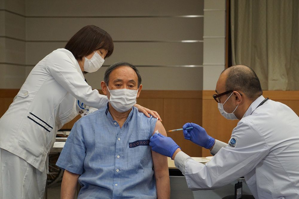Japan's Suga Gets COVID-19 Vaccine Ahead of U.S. Visit